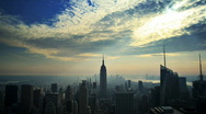 Stock Video Footage of Empire State Building with sunbeams time lapse