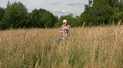 Farmer walking talking in a cellphone Stock Footage
