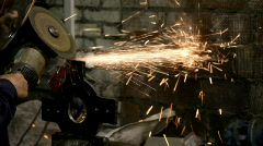 Man work with metal detail - sparkles fly out Stock Footage