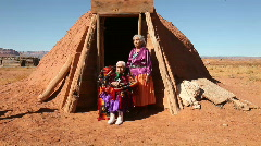 Handheld Shot of 2 Navajo Women Outside Their Hogan Stock Footage
