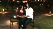 Stock Video Footage of Young lovers - park bench series - 4 - wide shots