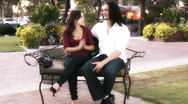 Stock Video Footage of Young lovers - park bench series - 8 - wide shots