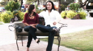 Young lovers - park bench series - 9 - wide shots Stock Footage