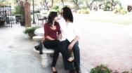 Stock Video Footage of Young lovers - park bench series - 1 - wide shots