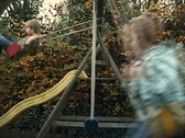 Playing on a swing Stock Footage