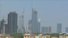 Zoom pan from emirate towers to burj dubai Stock Footage