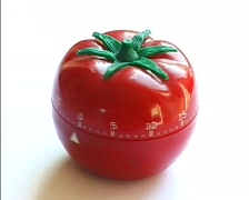 Spinning tomato egg-timer Stock Footage