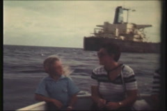 8 mm - mother and daughter in dingy - stock footage