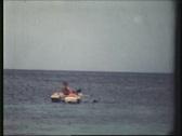 8 mm - kids playing in tropical ocean Stock Footage