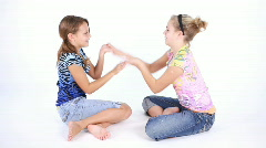 Girls playing hand games Stock Footage