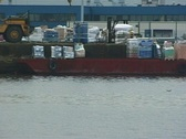 Unloading a ship in the harbour Stock Footage