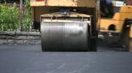 Steamroller flattens asphalt.  Stock Footage