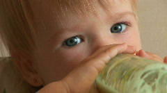 Child drinks milk from a bottle. Stock Footage