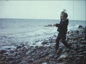 Boy throws stones into sea (vintage 8 mm amateur film) Stock Footage