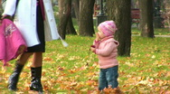 Mother and child walk past the camera Stock Footage