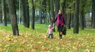 Stock Video Footage of Mother and child walk past the camera