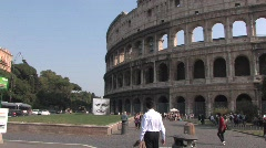 Man in front of the colosseum Stock Footage