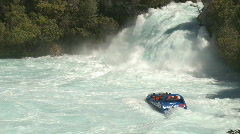 Waterfall and jet boat Stock Footage