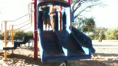 Preteens playing on slide - 3 Stock Footage