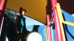 Preteens playing on slide - 6 Stock Footage