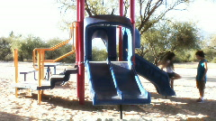 Preteens playing on slide - 9 Stock Footage