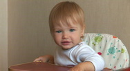 The baby is smiling at the camera. Then he turned away Stock Footage