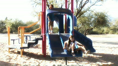 Preteens playing on slide - 10 Stock Footage