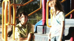 Preteens talking at a playground - 1 Stock Footage