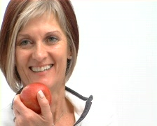 Mature healthy female with red apple 2 Stock Footage