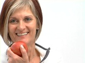Stock Video Footage of Mature healthy female with red apple 2