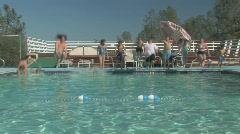KIDS JUMPING IN POOL Stock Footage