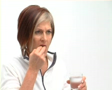 Mature female suffers from headache Stock Footage