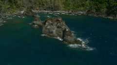 Stock Video Footage of Aerial (truly spectacular!) along Rock Formation in front of beach bay
