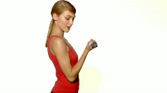Young beautiful and relaxed lady exercising with dumbells Stock Footage