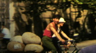 Stock Video Footage of 1970s China Men on bicycle - Vintage 8mm Film
