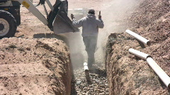 Shoveling Stone in Septic Drain Field Stock Footage