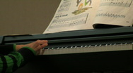 Db child playing piano Stock Footage
