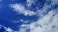 Clouds moving on blue sky Stock Footage