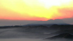Smokey sunset pan right into Mountains Stock Footage