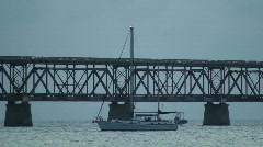 Bahia Honda Rail Bridge with Sailboat Stock Footage