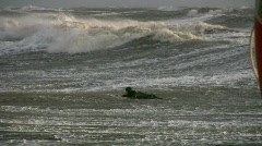 Surfer trying to catch the wave Stock Footage