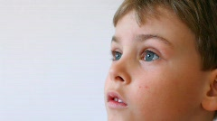 attentive boy watching something, side view - stock footage