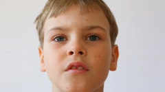 Boy watching something and being surprised, full-face Stock Footage