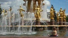 Little girl sitting at fountain friendship, All-Russia Exhibition Centre Stock Footage