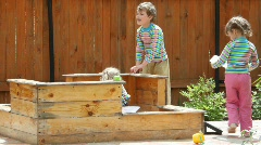 4 kids playing in sandbox Stock Footage