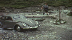 Volkswagen beetle crossing river (vintage 8 mm amateur film) Stock Footage