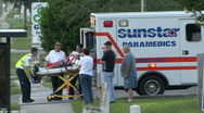Car Crash Victim on Stretcher Stock Footage