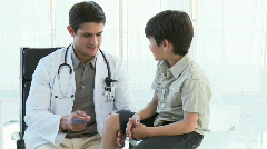 Attractive doctor checking kid's reflexes Stock Footage