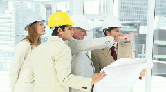 Architect team studying a building Stock Footage