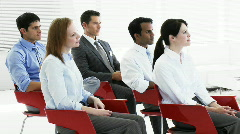 Business people applauding in a seminar Stock Footage